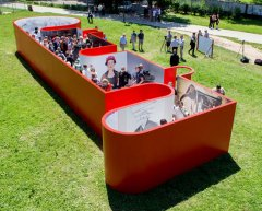 """O2S14, """"Outsourcing to Sarajevo"""" 2014, Sarajevo, commissioned by the federal Chancellery of Austria, an interactive public sculpture and exhibition platform, PCV, wood and metal fasteners and quests, 20 x 6 x 2 m"""
