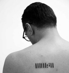 Slaven Tolj, Tattoo of the logo of Rijeka's Museum / MMSU, 2013, Photo, Baryt, 3 + 2 AP, 19 x 19 cm