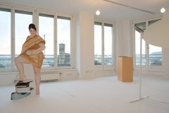 Life-long Weight-Gaining Stand-up (photo print, 170 x 60cm),  Postcard (21 x 14,8cm): Life-Long Weight-Gaining, 2013, Performance installation (solo exhibition) Neuer Kunstverein Wien, curated by Felicitas Thun-Hohenstein